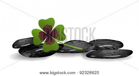 shamrock leaf and black stones isolated on white background