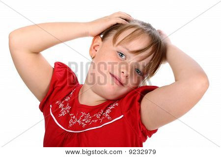 Happy little girl with hands in her hair isolated on white