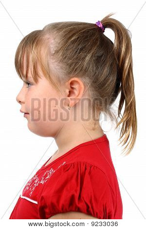 Small girl with pony tail dressed in red isolated on white