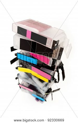 Empty ink cartridges stacked on white background