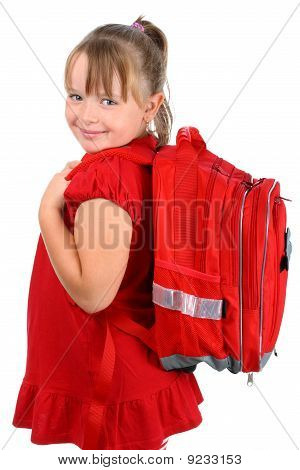 Small girl with red school bag smiling at camera isolated on white