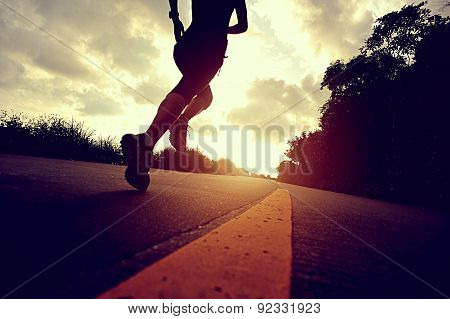 Runner athlete running at seaside road. woman fitness silhouette sunrise jogging workout wellness co