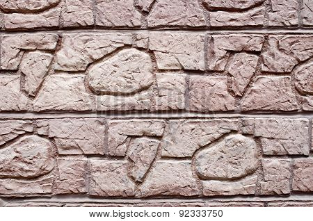Red Decorative Relief Plaster Imitating Stones On Wall