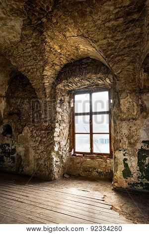 Old window of an abandoned house. Inside the old castle.