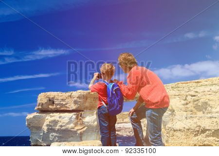 father and son making photo of Azure Window on Gozo island