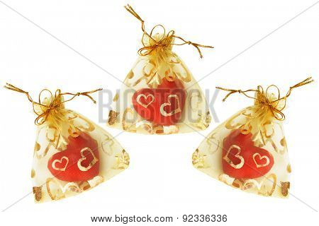Red Love Hearts in Golden Sachets on White Background