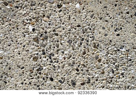 Plaster With Pebbles On Wall Closeup