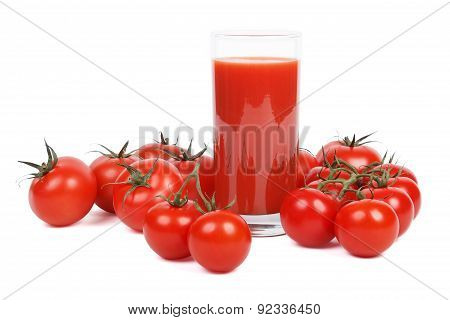Tomato juice and lots of tomatoes over white.