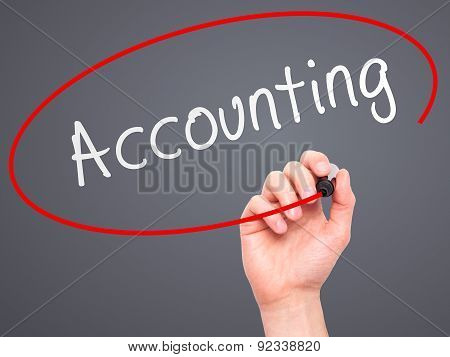 Man Hand writing Accounting with marker on transparent wipe board.