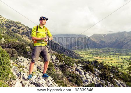 Hiking Man Checking Direction In Mountains