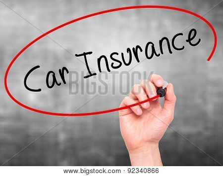 Man Hand writing Car Insurance with marker on transparent wipe board.