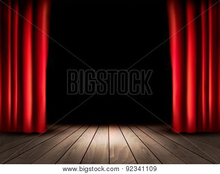 Theater stage with wooden floor and red curtains.