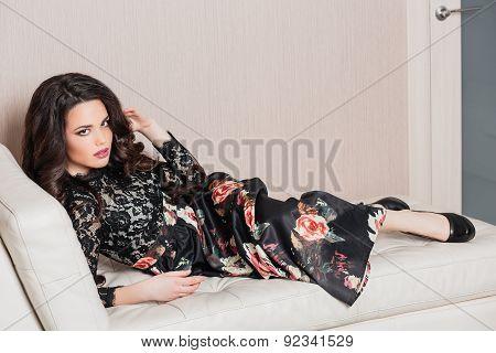 beautiful girl long brown curly hair in a dark dress