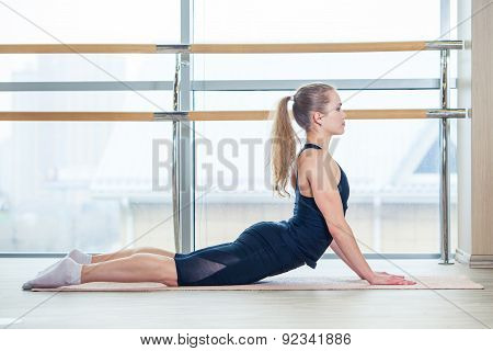 fitness, sport, training and lifestyle concept -  woman doing exercises on mat in gym