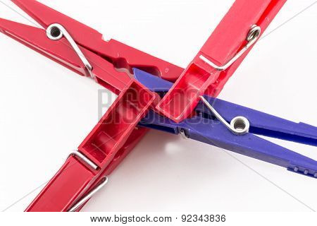 Three Red Pegs Attacking Blue Peg