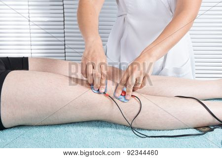 Therapist Placing Lots Of Electrodes On Body