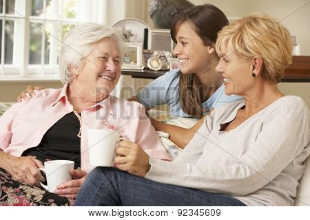 Adult Daughter With Teenage Granddaughter Visiting Grandmother