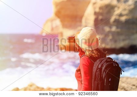 Tourist making photo of Azure Window in Gozo island