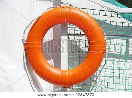 Orange Lifebuoy On White Ship Board.