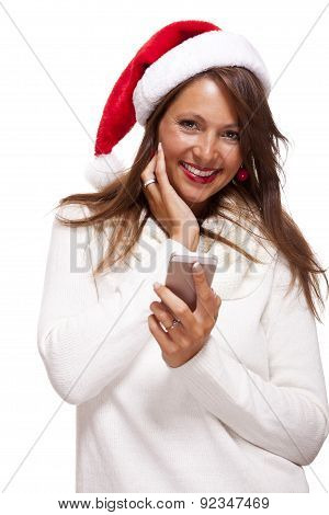 Pretty Woman In A Santa Hat Reading An Sms