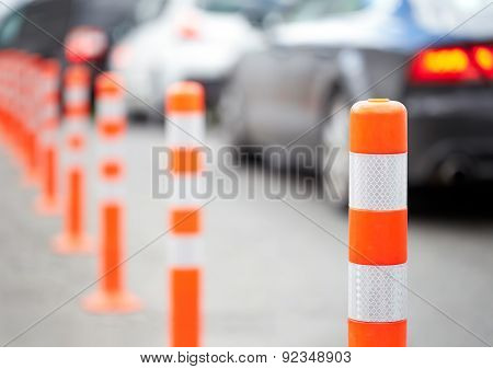 Orange Bollard On The Road. Traffic Jam.