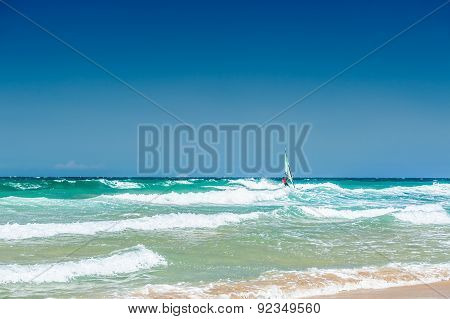 Tropical Beach With Turquoise Water And Big Waves