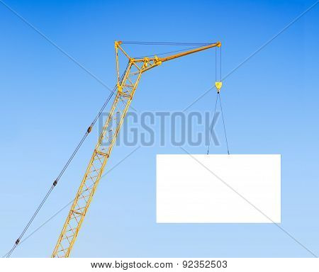 Hoisting Crane With Empty Board Against The Blue Sky