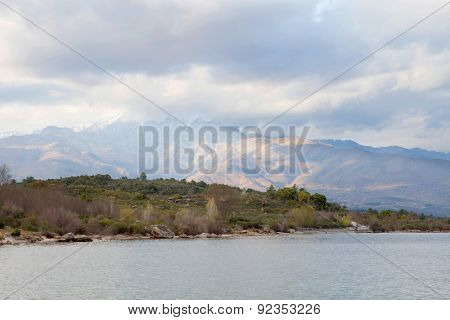 Peaceful lake at the foot of the Sierra de Gredos within Spain