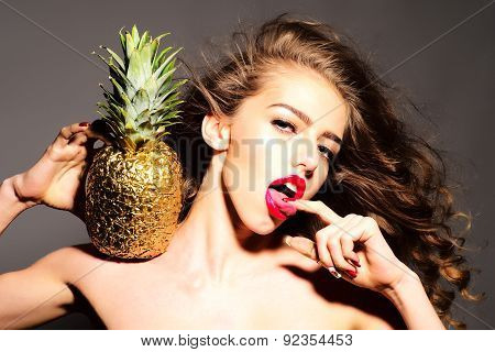 Sensual Young Girl With Golden Pineapple