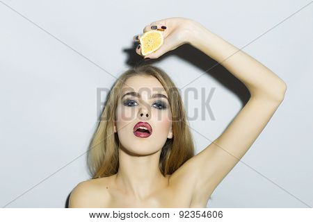 Passionate Blonde Girl Portrait With Orange