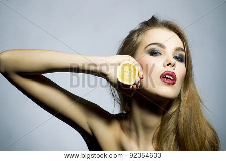 Passionate Blonde Woman Portrait With Orange