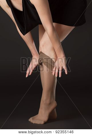 A Woman Takes Off Stockings