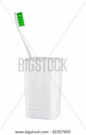 Toothbrush In Glass On A White Background