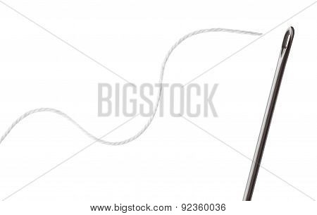 Needle And Thread On A White Background