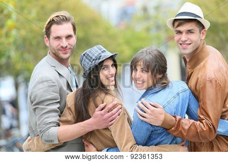 Group of young people hanging out together in town