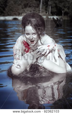 Beautiful Vampire Woman Dressed White Bloody Shirt And Her Victim