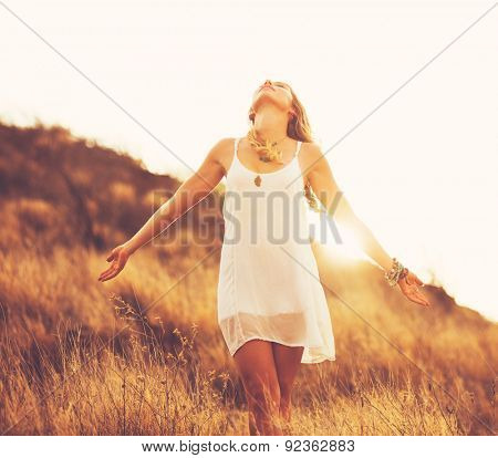 Young Woman Outdoors Fashion Lifestyle Portrait. Soft warm sunny colors. Happy free lifestyle.
