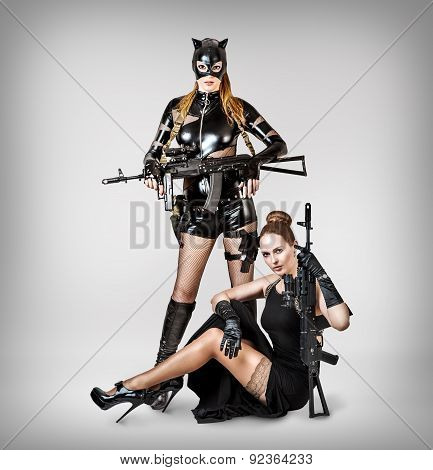 Two Sexy Models Holding Automatics