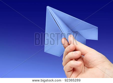 paper plane in hand on background blue sky