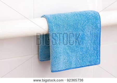 Blue towel or rag drying on a dryer