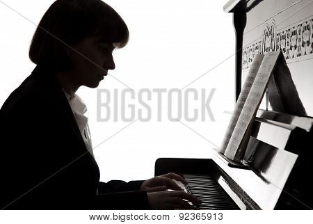 musician plays piano, silhouette on white background