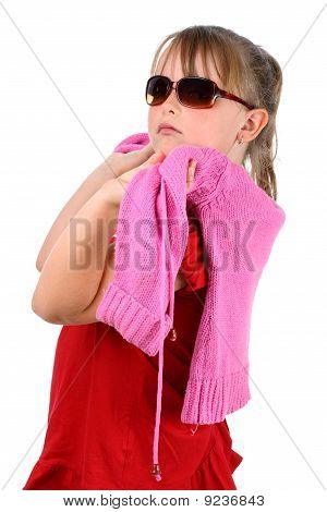 Proud small girl with pink sweater looking at camera isolated on white