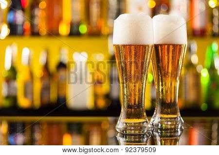 Jugs of beer placed on bar counter with free space for text
