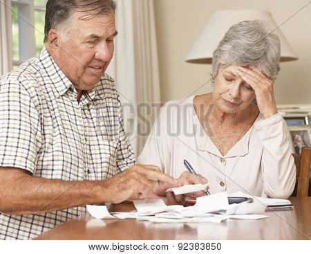 Senior Couple Concerned About Debt Going Through Bills Together