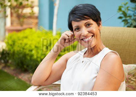 Portrait Of Mature Woman Relaxing Outdoors In Garden