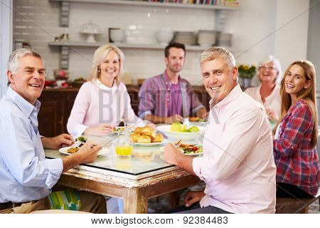 Portrait Of Friends Enjoying Meal At Home Together