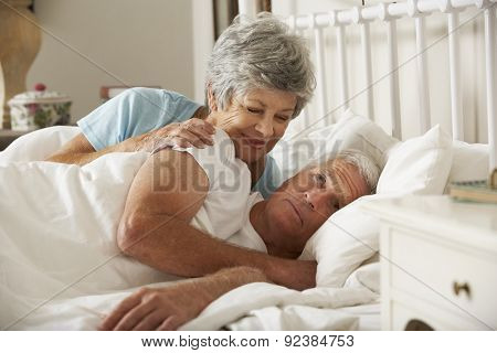Senior Man Having Difficulty In Sleeping In Bed With Wife