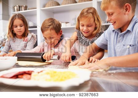 Children making pizza together