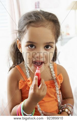 Young Girl Dressing Up And Putting On Make Up