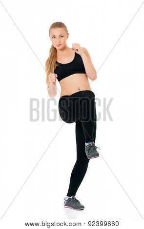 Young happy woman doing fitness exercise, isolated on white background